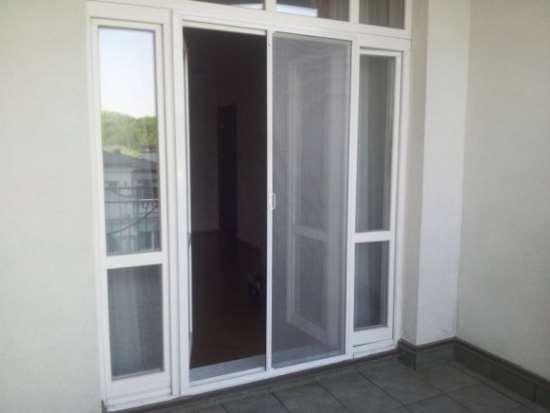 Антимоскитная сетка на дверь: конструкция и преимущества